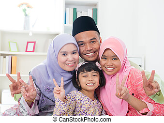 Asian family showing v victory hand sign