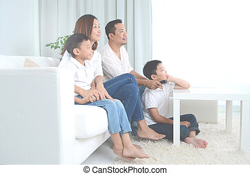 Asian family stay at home - Asian happy family sitting and ...