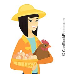 Asian farmer holding chicken and basket of eggs.