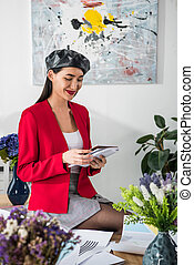 asian fashion designer with notebook