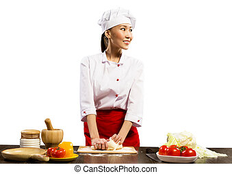 Asian female chef cooking pizza dough