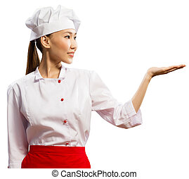 Asian female chef shows his hand in place for the text,...
