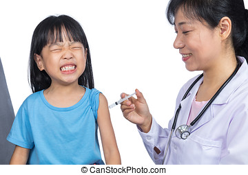 Asian female doctor giving a Chinese little girl injection