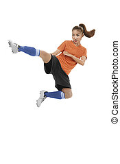 Asian female football player kick ball