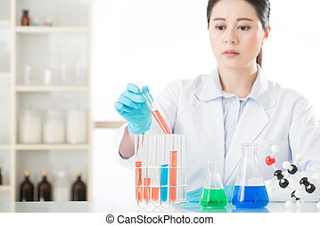 Asian female forensic scientist Working on that miracle cure