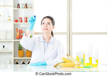 Asian female scientist recording the result on writing glass in laboratory
