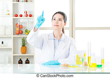 Asian female scientist research on touch screen