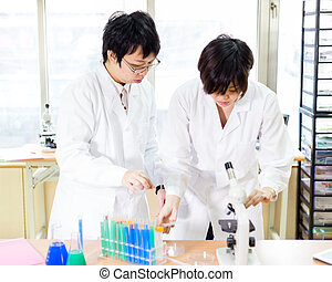 Asian female scientists in lab