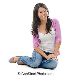 Asian female sitting on floor