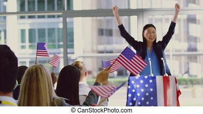 Asian female speaker speaks in a political campaign seminar ...