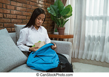 asian female teenager junior highschool student preparing for school