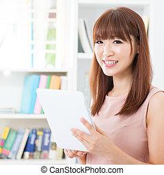 Asian female using tablet