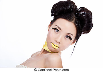 Asian female with creative colorful makeup