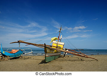Asian fishermen's boats on beach