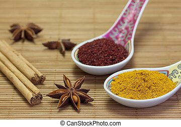 Asian flavour. - Assorted Asian spices on a bamboo mat.