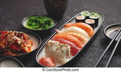 Asian food assortment. Various sushi rolls placed on ceramic...