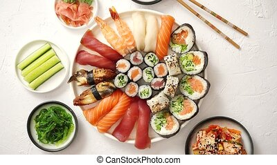 Various sushi rolls placed on round ceramic plate - Asian ...