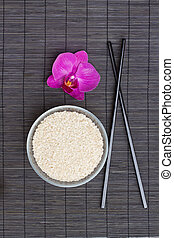asian food concept - plate with rice and chopsticks