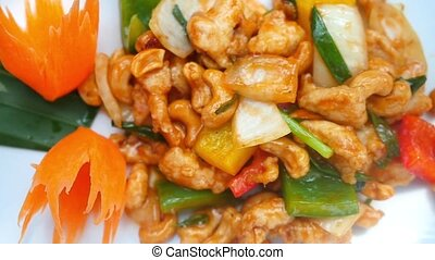 Asian food in slow motion. Stir fried chicken, vegetables with cashews.