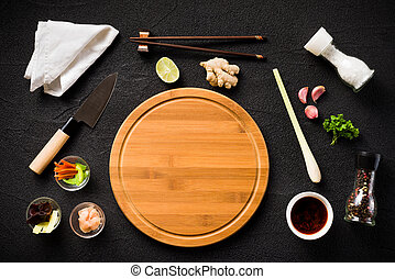 Asian food ingredients and cutting board top view