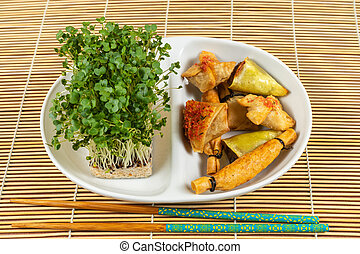 Asian food selection. Duck cones, parcels, baskets with ginger and soy sauce, tikka crackers, cress salad