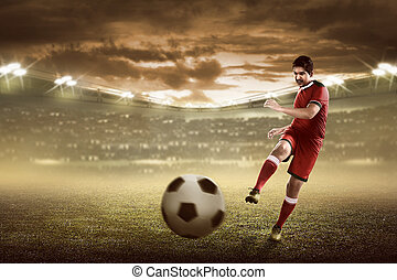 Asian football player kick ball