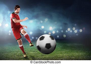 Asian football player kick ball