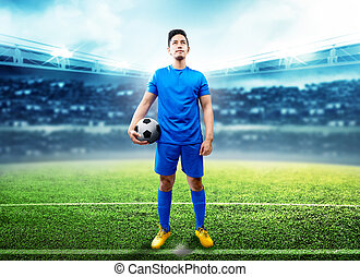 Asian football player man holding the ball in the middle