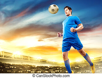 Asian football player man jump in the air and heading the ball