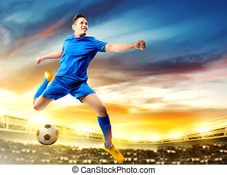 Asian football player man jumping and kicking the ball in the air