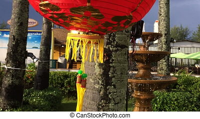 Asian fountain and street lamp
