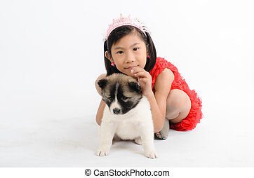 Asian girl and Thai Bang Kaew puppy
