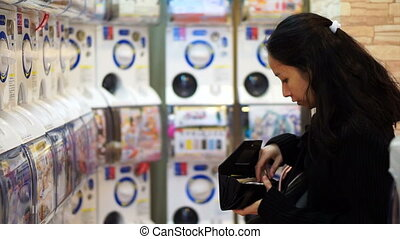 Asian girl and toy vending machine - Osaka, Japan - March...