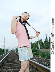 Asian Girl - asian girl at rail