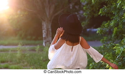 Asian girl beautiful female portrait  walking away to sun