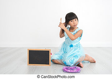 Asian girl brushing her hair at home.