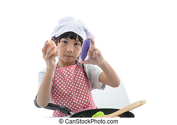 Asian girl cooking at home