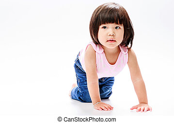 asian girl crawl and looking in left isolate