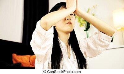 Asian girl doing yoga at home