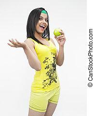asian girl eating a green apple
