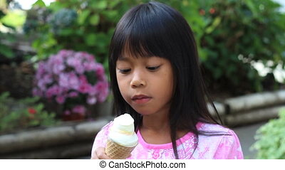 Asian Girl Eating Ice Cream Cone