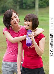 asian girl friends having fun after a workout outdoor