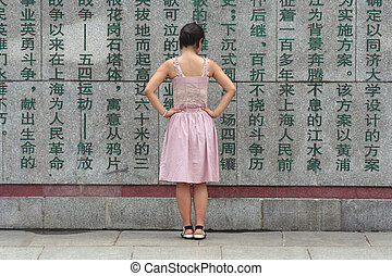 Asian girl - Girl looking chinese carved characters