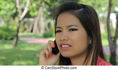 Asian Girl Having A Cell Phone Call