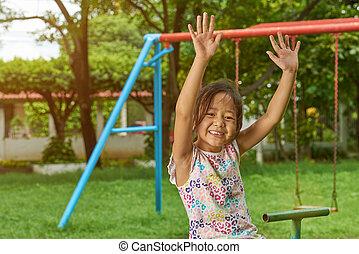 Asian girl having fun in park