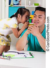 Asian girl having fun with dad