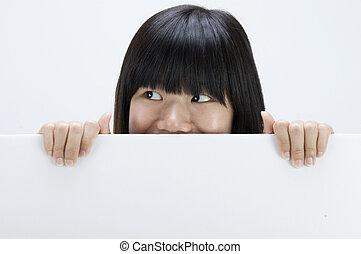asian girl hiding with a blank card board