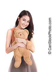 Asian girl hud a teddy bear