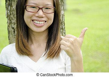 asian girl humbs up