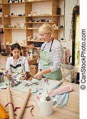 Asian Girl in Floists Workshop